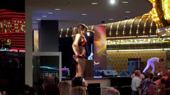 Go-Go dancer at the openair bar at Fremont Street Experience (FSE). - stock footage