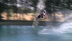 WAKEBOARDER WAKE BOARD RIDER DOING A FLIP WITH SOFT FOCUS UNIDENTIFIABLE HD 1080 Stock Footage
