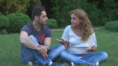 Young couple have discussion in park Stock Footage