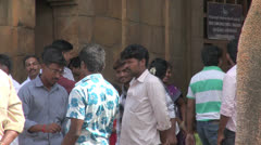 India Tamil Nadu Thanjavur temple two men blessed by elephant trunk 7 Stock Footage