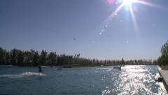 TIME LAPSE WAKEBOARD RIDERS AT CABLE WATER PARK HD 1920X1080 FOOTAGE CLIP Stock Footage