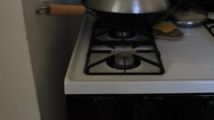 Heating a non stick pan Stock Footage
