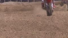 DIRT BIKE PRO MOTOCROSS RACER GOING THROUGH BUMPS IN SLOW MOTION HD 1080 Stock Footage