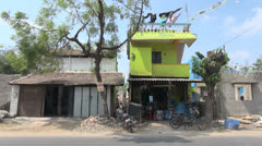 India Tamil Nadu laundry on roof of yellow house Stock Footage