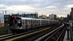 NYC subway trains roll in and out of station Stock Footage