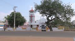 India Tamil Nadu church tower and tuk tuk Stock Footage