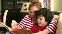 Mother reading with her son Stock Footage
