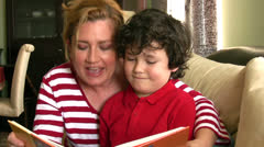 Mother and child reading Stock Footage