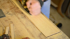 Carpenter with a wood planer Stock Footage