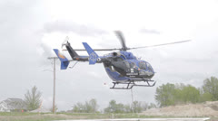 1080p Stock Footage - Life FLight helicopter take off and hover -  Shot flat Stock Footage