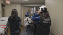 1080p Stock Footage - Life FLight crew rushing patient through hospital - Flat Stock Footage