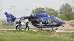 1080p Stock Footage - Life Flight, passenger being loaded by crew - Audio Stock Footage