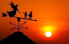 weather vane at sunset - stock photo