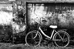 old bicycle and brick wall - stock photo