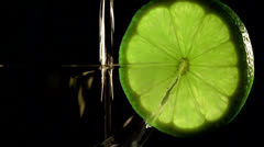 Lime with a glass. Close up - stock footage
