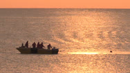 Stock Video Footage of A small fishing boat at sea at sunrise