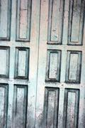 wooden door with a faded paint - stock photo