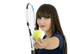 a pretty, athletic female tennis player isolated on a white background. - stock photo