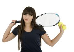 Stock Photo of a pretty, athletic female tennis player isolated on a white background.