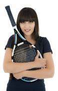 A pretty, athletic female tennis player isolated on a white background. Stock Photos