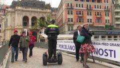 Policeman riding a segway Stock Footage