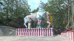 India Tamil Nadu horse statue on red striped base 1 Stock Footage