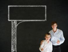 Thumbs up boy business man and teacher with chalk road advertising sign Stock Photos