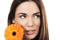 Stock Photo of woman portrait with orange flower