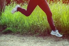 feet of a running woman - stock photo