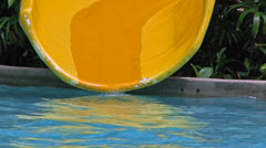 Child riding on water slide. Stock Footage