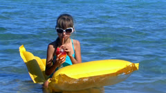 Child swimming on inflatable beach mattress. Stock Footage