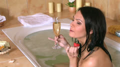 Woman drinking champagne. Stock Footage
