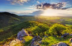 green rocky moutain at sunset - slovakia - stock photo