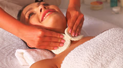 Woman getting facial massage in spa. Stock Footage
