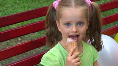 Child eating ice-cream. Stock Footage