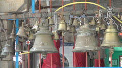 India Tamil Nadu Chettinad bells hung on temple fence Stock Footage