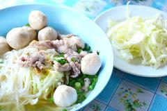 Noodle soup with meat ball and fresh vegetable Stock Photos
