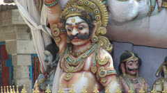 India Tamil Nadu Chettinad temple statue of scowling god Stock Footage
