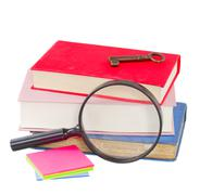 School stationery and looking glass Stock Photos