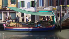 Venetian vegetable market in boat along quay Stock Footage