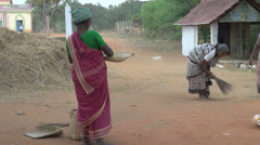 India Chettinad women with rice straw editorial s2 Stock Footage
