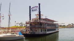 Grand Romance Riverboat Paddlewheeler In Rainbow Harbor Stock Footage