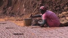 India Tamil Nadu brick works woman lifts brick form 4 Stock Footage