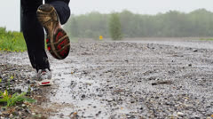 Running in bad weather - stock footage