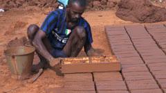 India Tamil Nadu brick works man lifts brick form 2 Stock Footage