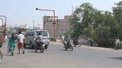 India Tamil Nadu people in robes walk with honking traffic 3 Stock Footage