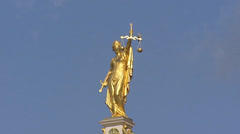 Gilded statue of Lady Justice zoom out historic building city square Burg Stock Footage