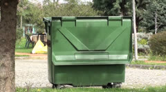 Garbage container in park zoom out - stock footage