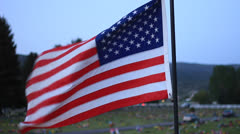 U.S. Flag Over Cemetery Stock Footage