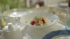 Fruit salad on a breakfast plate on a decorated table Stock Footage